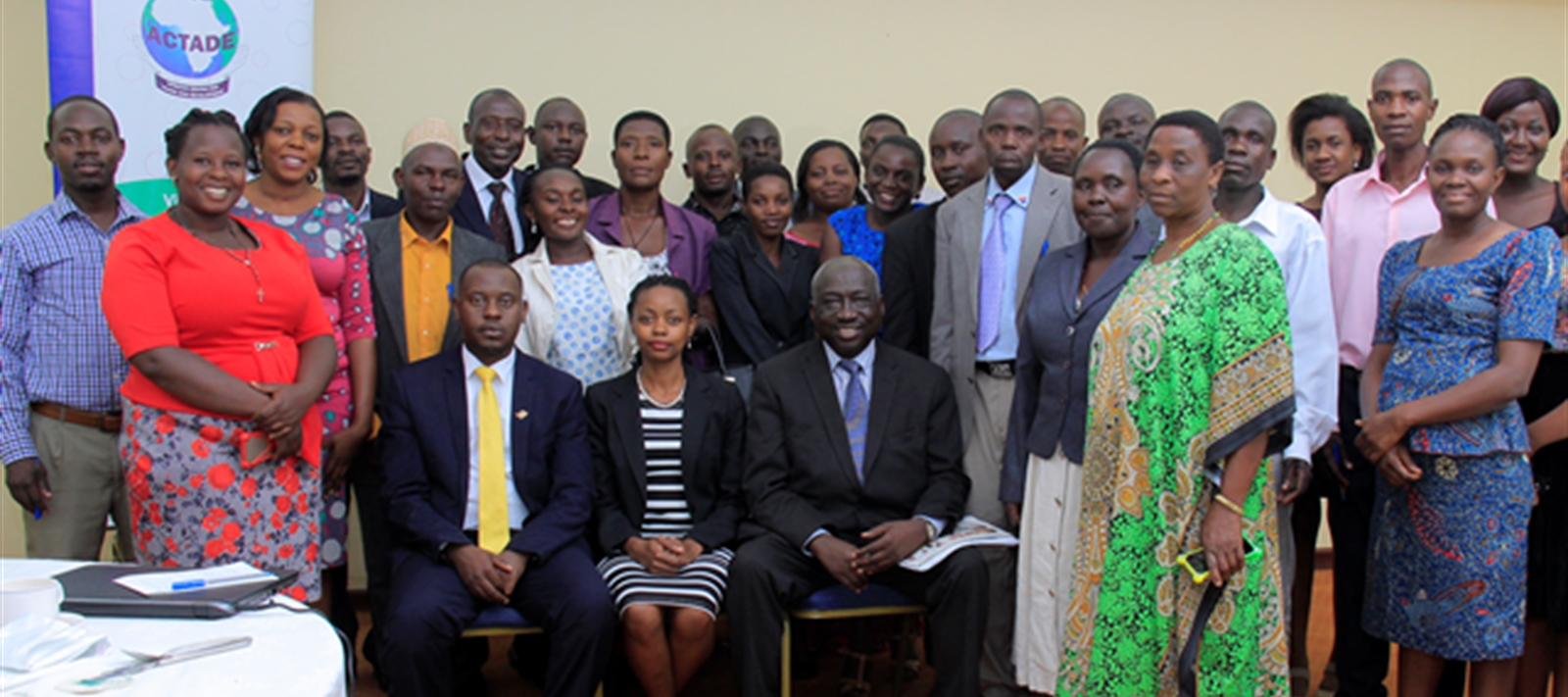 Group Photo: Hon. Onesmus Twinamasiko left, Susan Nanduddu (ED, ACTADE) and Hon. L. N. Bategeka (MP-Hoima Municipality) together with the Local leaders of Bunyoro during ACTADE's National level dialogue on Local Government budget accounatability